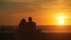 stock-footage-silhouette-of-couple-during-beach-sunset